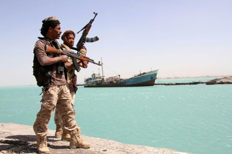Yemeni pro-regime forces patrol the port of Mokha, on February 9, 2017