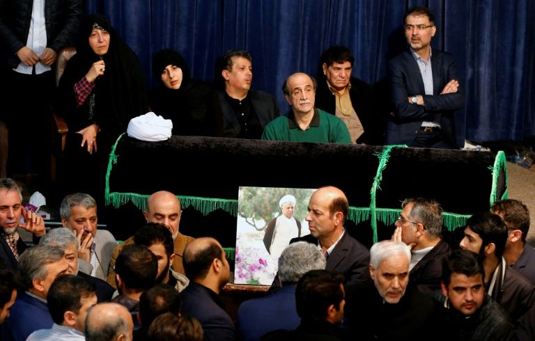 Fatemeh Hashemi Rafsanjani (L), the daughter of late former Iranian president Akbar Hashemi Rafsanjani, gathers with relatives and mourners around around Rafsanjani's coffin during a mourning ceremony at Jamaran mosque in Tehran, on January 8, 2017