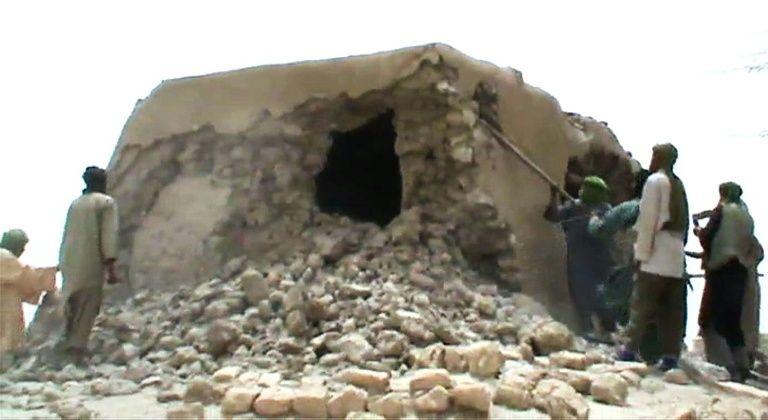 Islamist militants destroy an ancient shrine in Timbuktu in 2012