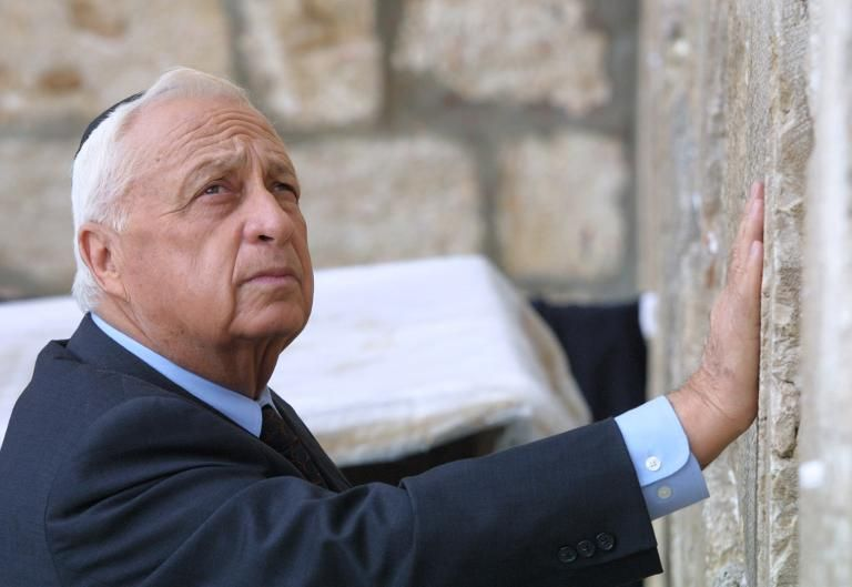 Israeli Prime Minister-elect Ariel Sharon places his hand on the Western Wall, Judaism's holiest site, in the Old City of Jerusalem on February 7, 2001