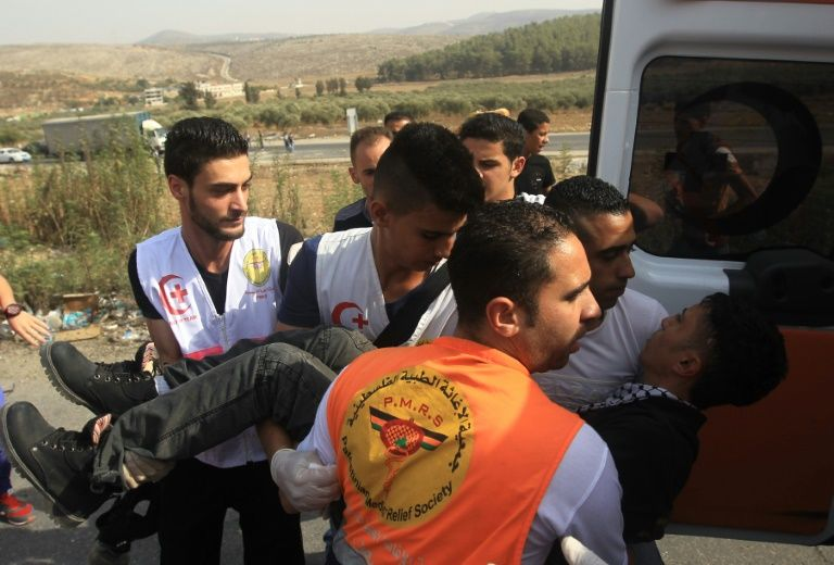 Medics say Palestinians hurt in West Bank settler clashes