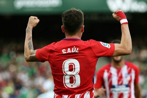 Atletico Madrid's midfielder Saul Niguez celebrates after scoring a goal during the Spanish league football match against Real Betis December 10, 2017