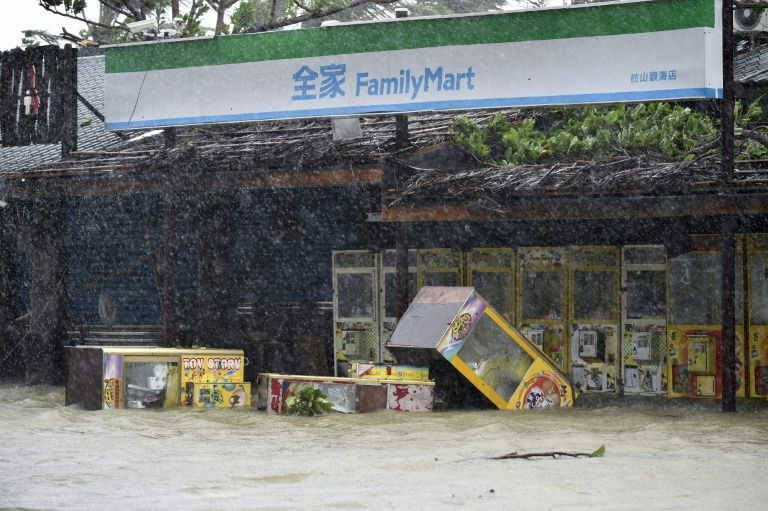 Parts of Taiwan were brought to a standstill on September 14 as the strongest typhoon of the year skirted past the island's southern tip, knocking out power for more than 300,000 households