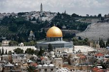 The Dome of the Rock pictured inside the Al-Aqsa mosque compound surrounded by houses in Jerusalem's Old City, with the Mount of Olives in the background, on March 17, 2016
