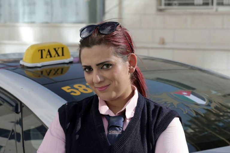 Jordanian taxi driver Nisrin Akoubeh works a gruelling 10-hour shift in her taxi -- a rare occupation for a woman in the conservative Muslim society