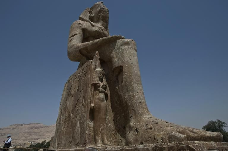 A statue of pharaoh Amenhotep III and his wife Tiye are unviled in Egypt's temple city of Luxor on March 23, 2014