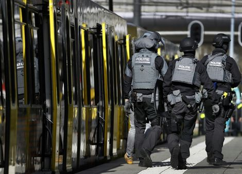 Armed police and emergency services swarmed the scene after the shooting in the city of Utrecht