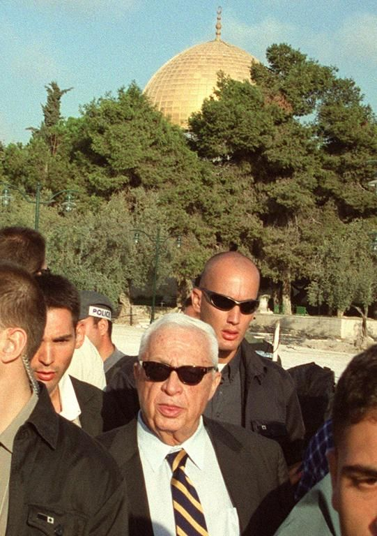 Israeli right-wing opposition leader Ariel Sharon (C) is flanked by security guards as he visits the Al-Aqsa mosque compound in Jerusalem's Old City on September 28, 2000