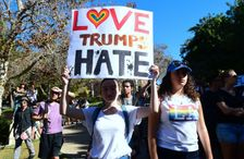 """University of California Los Angeles students march through campus during a """"Love trumps Hate"""" rally"""
