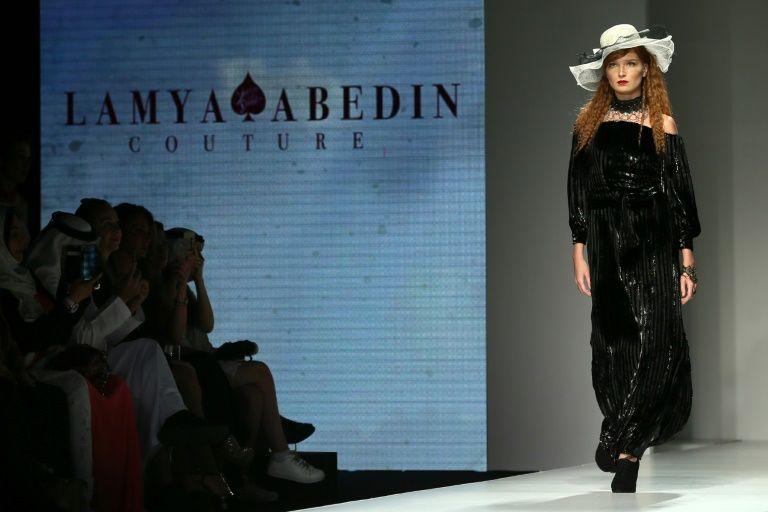 A model presents a creation by Emirati fashion designer Lamya Abedin at the Arab Fashion Week in Dubai on October 6, 2016