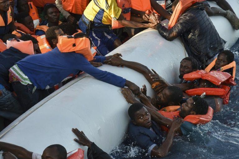 Libyan coastguards rescue migrants, almost 100 feared missing