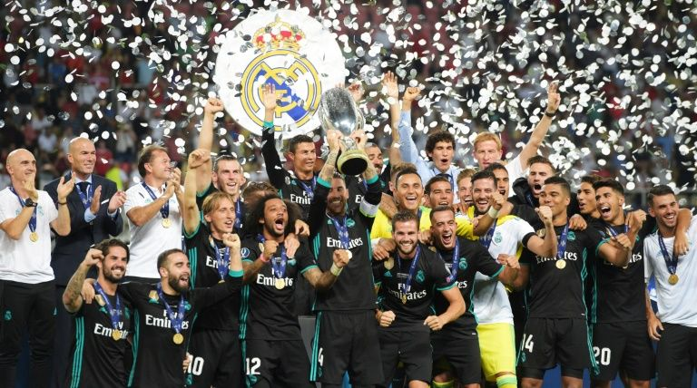 Real Madrid's players celebrate with the trophy after winning the UEFA Super Cup