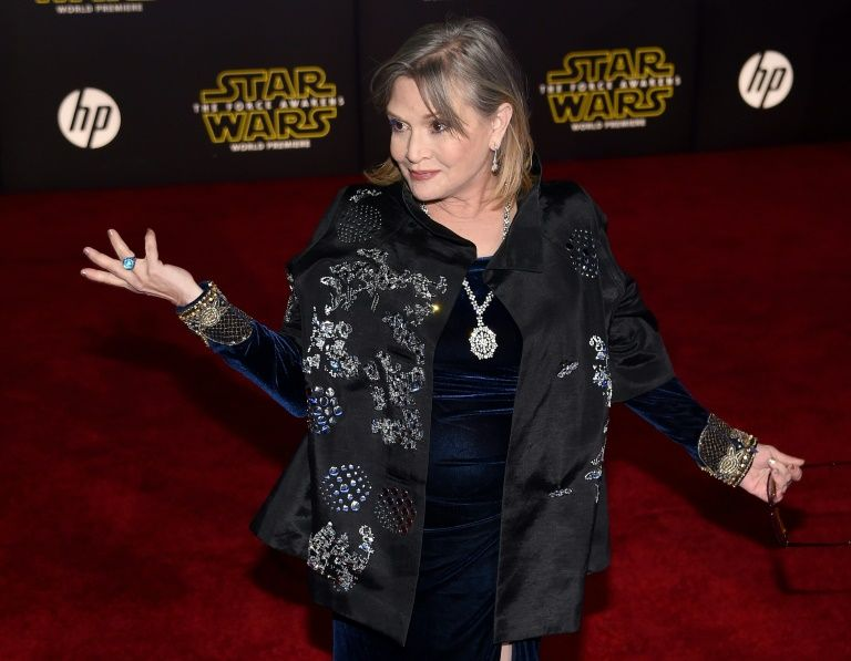 "Actress Carrie Fisher, pictured in 2015, was catapulted to worldwide stardom as the rebel warrior Princess Leia in the original ""Star Wars"" trilogy"