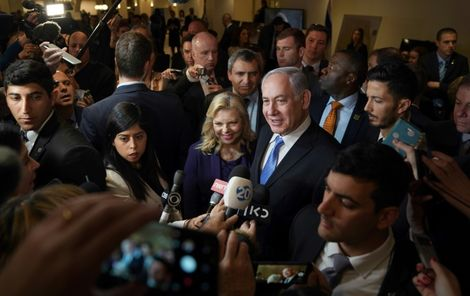 "Israeli Prime Minister Benjamin Netanyahu and his wife Sara Netanyahu talk to the press after they attend an  exhibit entitled ""3000 years of history: Jews in Jerusalem"" at the Unted Nations"
