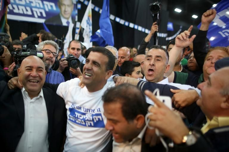 Israeli Likud Party supporters celebrate after the exit polls were announced on March 17, 2015 at the party's headquarters in the Israeli city of Tel Aviv