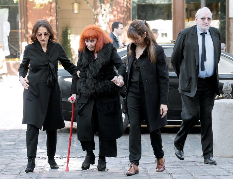French fashion designer Sonia Rykiel, accompanied by her daughter Nathalie Rykiel (L), attends the funeral of French author Regine Deforges in 2014