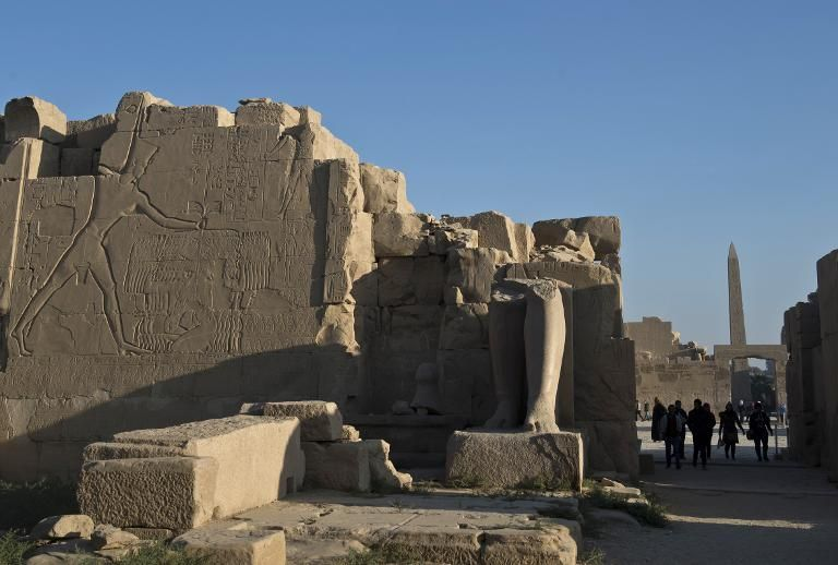 Tourists visit the Temple of Karnak, in the southern Egyptian city of Luxor, on December 21, 2013