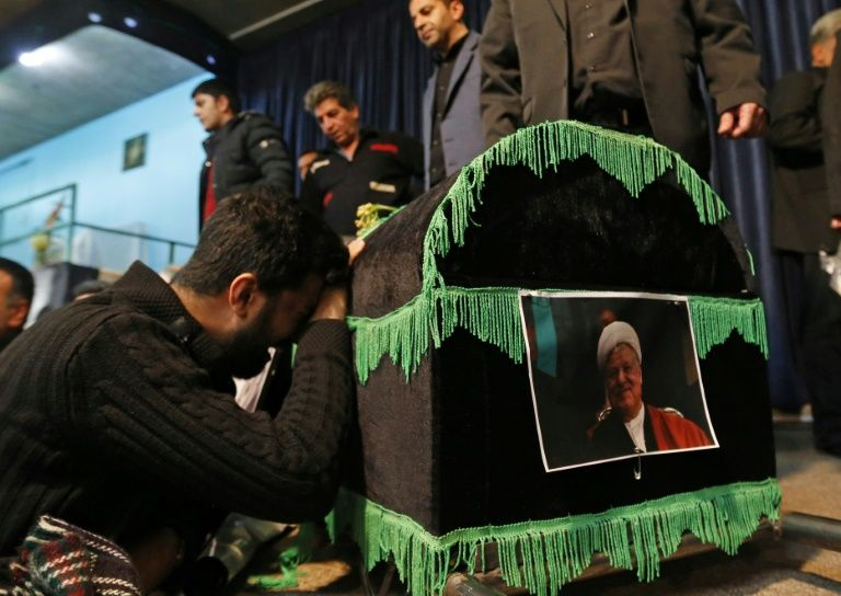 Mourners gather around the coffin of former Iranian president Akbar Hashemi Rafsanjani during a mourning ceremony in Tehran, on January 9, 2017