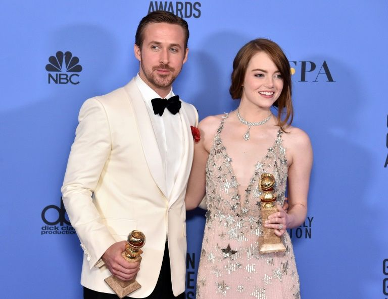 Actor Ryan Gosling (L) and actress Emma Stone pose in the press room during the 74th Annual Golden Globe Awards, at The Beverly Hilton Hotel in Beverly Hills, California, on January 8, 2017