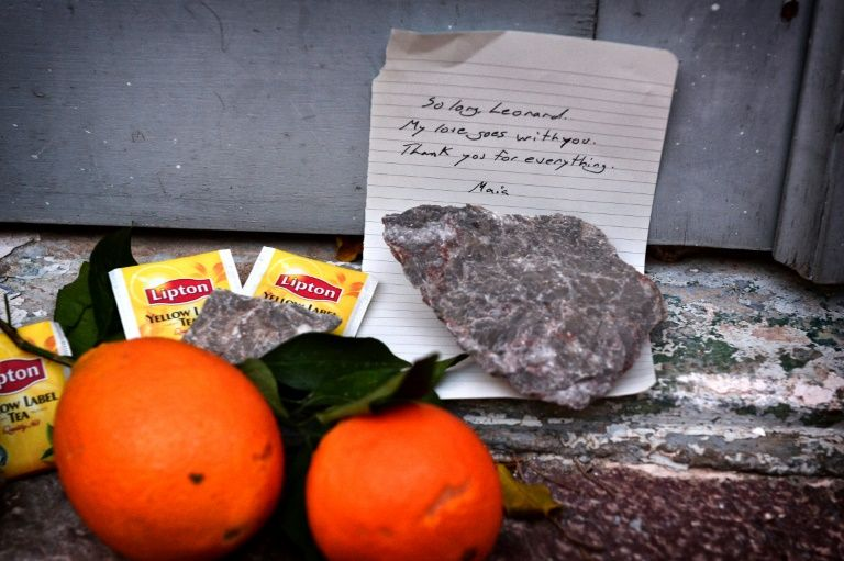 Stones, tea bags and oranges placed outside the summer house of late Canadian singer-songwritter and poet Leonard Cohen, on the Greek island of Hydra, on November 11, 2016