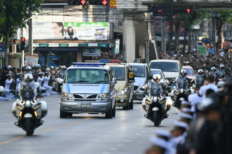 Crowds line the streets in Bangkok as the body of late Thai King Bhumibol Adulyadej is taken to his palace on October 14, 2016