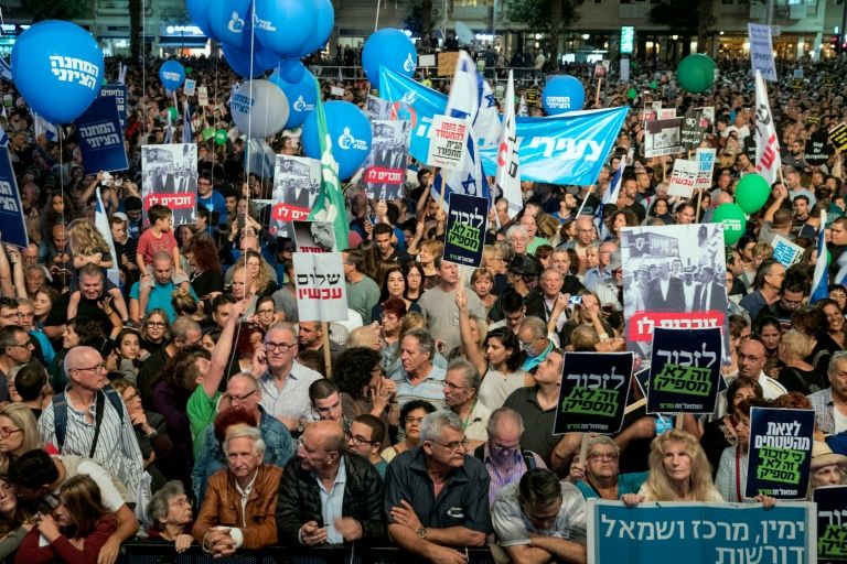 Organizers for a November 5, 2016 peace rally in Tel Aviv honoring slain Israeli premier Yitzhak Rabin said about 50,000 people attended, while Israeli media said 20,000