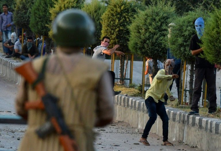 Kashmiri protesters throw stones after Indian paramilitary troops fired tear gas during clashes in Srinagar on July 21,2016