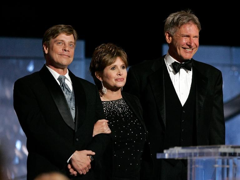 L-R: Actors Mark Hamill, Carrie Fisher and Harrison Ford speak during an tribute to George Lucas at the Kodak Theatre on June 9, 2005 in Hollywood, California