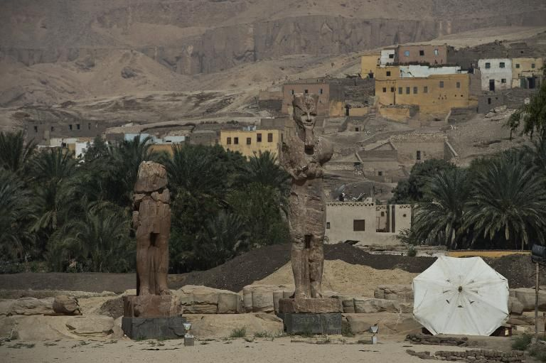 Statues of pharaoh Amenhotep III are unveiled in Egypt's temple city of Luxor on March 23, 2014