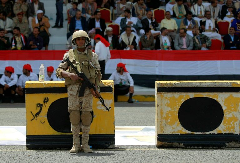 A member of the Yemeni security forces loyal to the Shiite Huthi movement stands guard during celebrations marking the 26th anniversary of Yemen's 1990 reunification in the capital Sanaa