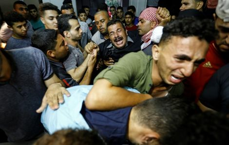 Palestinian relatives react as they arrive at the morgue of the al-Shifa hospital in Gaza City where the body of Mohammed Badwan was brought after he was shot dead by Israeli forces during protests along the border east of Gaza City on July 20, 2018