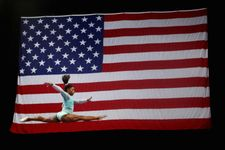 Simone Biles becomes first gymnast ever to win 13 world gold medals
