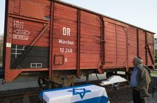 An Israeli man looks at a train wagon used in Nazi Germany to transport Jews to concentration camps, on April 15, 2015, in the coastal city of Netanya