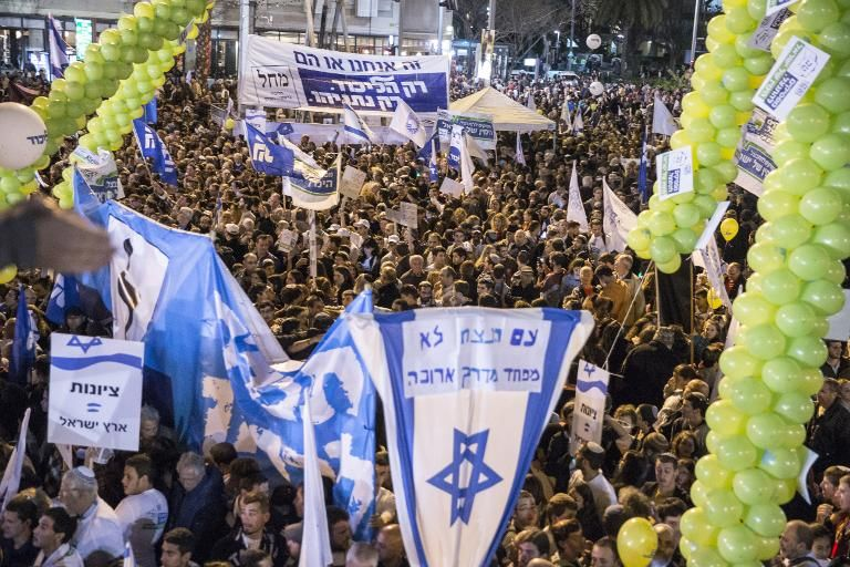 Supporters of Israeli Prime Minister and Likud party's candidate in the general elections, Benjamin Netanyahu, attend his campaign meeting on March 15, 2015, in Rabin Square in the Israeli costal city of Tel Aviv