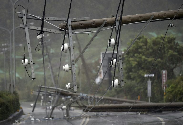 Collapsed power lines partially block a road as super typhoon Meranti skirts Pingtung county in southern Taiwan on September 14, 2016