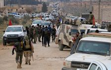 Turkey-backed-opposition fighters regroup as they advance on the western outskirts of the northern Syrian city of al-Bab in a bid to enter the city and retake control of it from the Islamic State (IS) group on February 9, 2017
