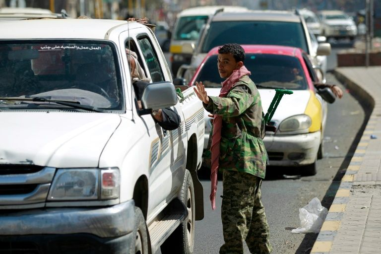 A Yemeni member of Iran-backed Shiite Huthi group mans a checkpoint on a street in the capital Sanaa
