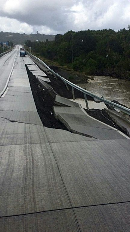 View of a bridge damaged by a 7.7-magnitude earthquake in Castro on Chiloe Island, southern Chile, on December 25, 2016