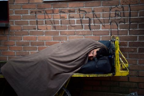 A Venezuelan migrant rests at the border between Colombia and Ecuador on August 11, 2018