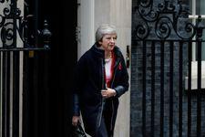 Brexit: aval du gouvernement britannique au projet d'accord (May)