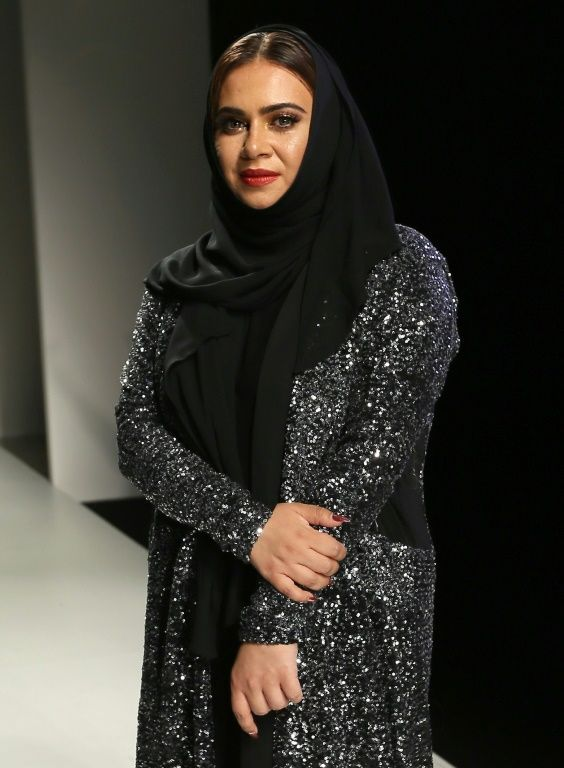 Emirati fashion designer Lamya Abedin appears on the runway following her show at the Arab Fashion Week in Dubai on October 6, 2016