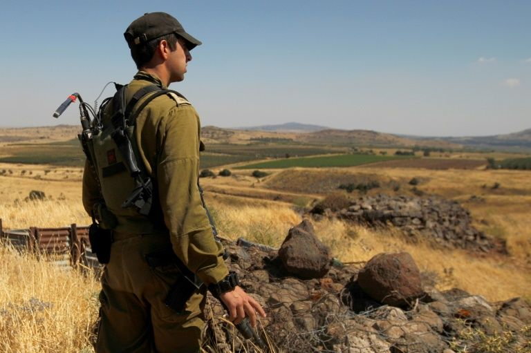 Israel warns Syria after stray fire hits Golan