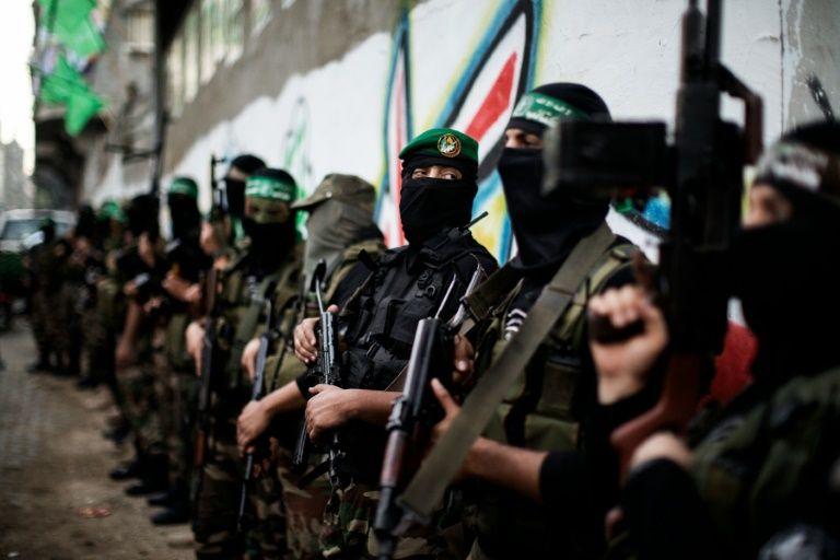 Des combattants des brigades Ezzedine al-Qassam lors des funérialles d'un de leur responsable, le 22 novembre 2012 à Gaza