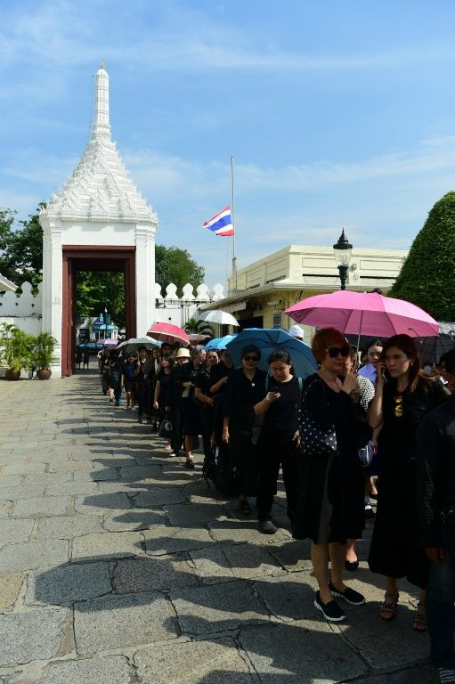 Thais dressed in black line up to pay last respects to their late King Bhumibol Adulyadej, the Grand Palace in Bangkok, October 14, 2016.