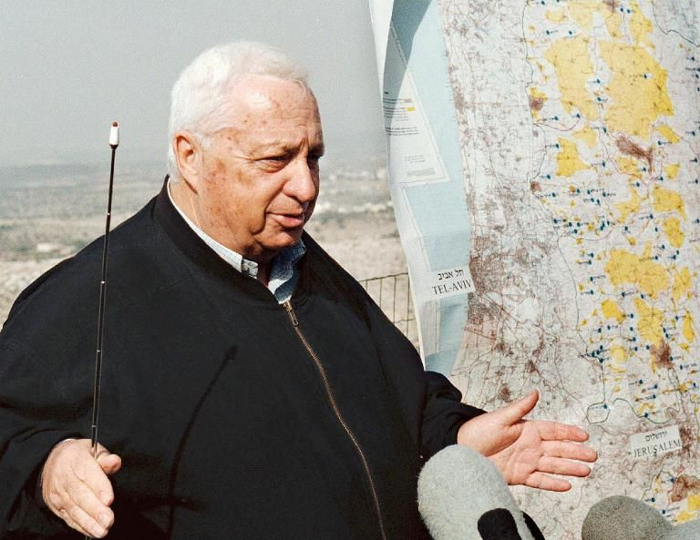 Ariel Sharon adresses reporters on December 5, 1997 in the West Bank town of Peduel