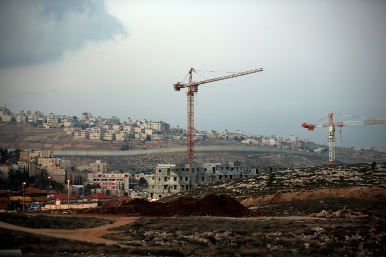 Israel's controversial wall separating the Jewish settlement of Neve Yaakov (foreground) in the northern area of east Jerusalem and the Palestinian neighborhood of al-Ram (background) in the West Bank