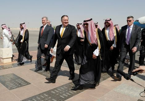 US Secretary of State Mike Pompeo (C) walks with Saudi Foreign Minister Adel al-Jubeir (C-R) after arriving in Riyadh on October 16, 2018 for urgent talks with King Salman on the disappearance of Saudi journalist and US resident Jamal Khashoggi