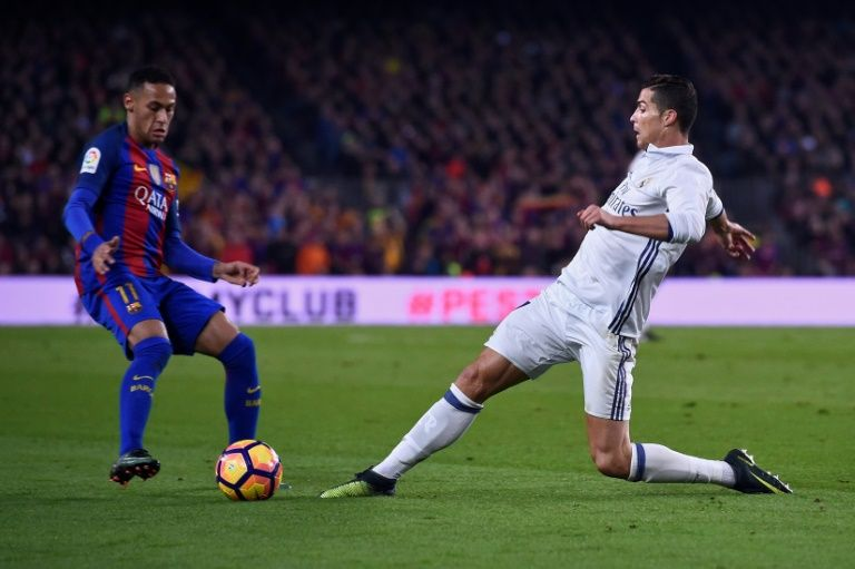 Barcelona's Brazilian forward Neymar (L) vies with Real Madrid's Portuguese forward Cristiano Ronaldo during the Spanish league football match FC Barcelona vs Real Madrid CF at the Camp Nou stadium in Barcelona on December 3, 2016