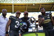 (L-R) Jerry Rice, Team Irvin quarterback Russell Wilson of the Seattle Seahawks, Michael Irvin and defensive end Michael Bennett of the Seattle Seahawks pose with the Pro Bowl Trophy at the end of the 2016 NFL Pro Bowl on January 31, 2016 in Honolulu