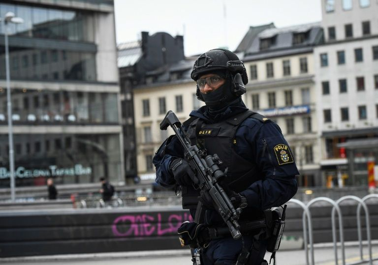 Stockholm: Man armed with knife stabs police officer in busy square